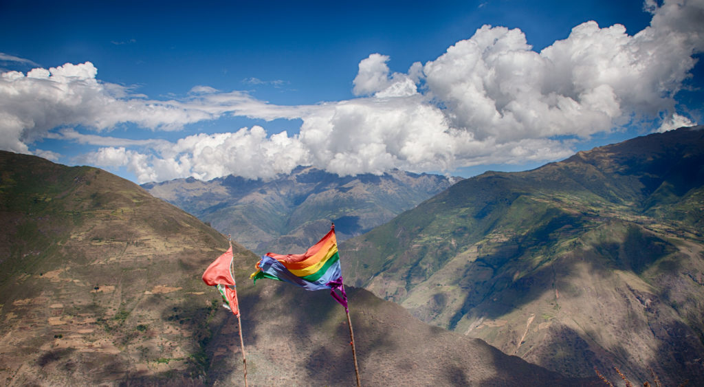 Cusco flag flying in front of mountains - Marampata, Peru